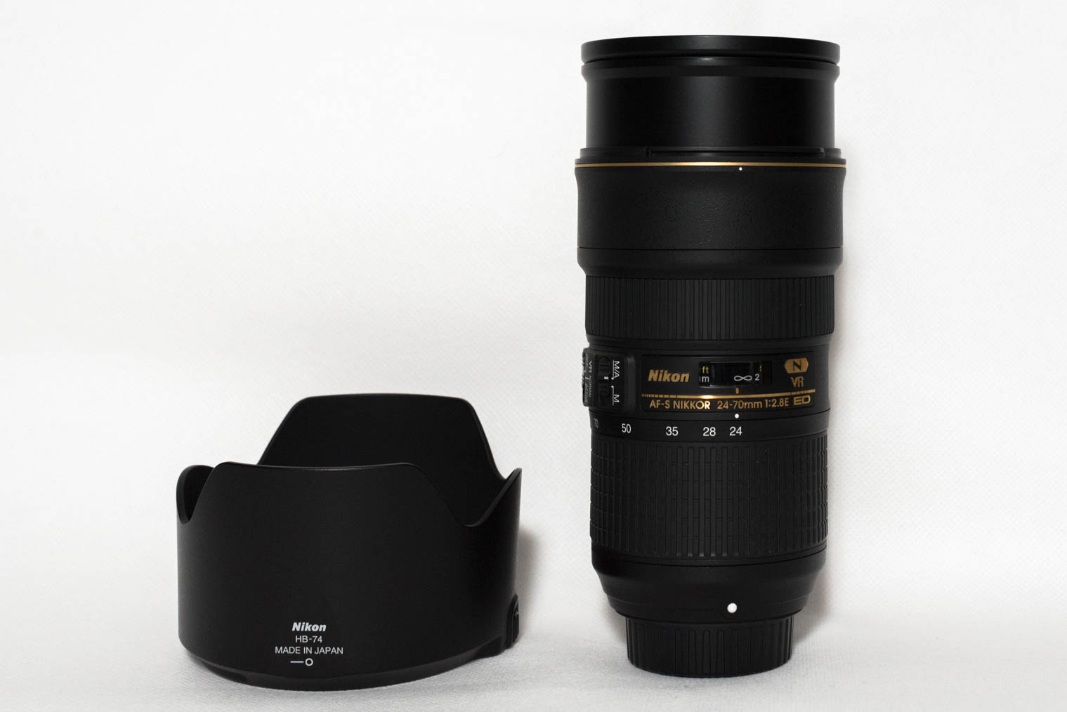 Nikon AF-S Nikkor 24-70 mm f/2.8 ED VR at 24 mm and the lens hood